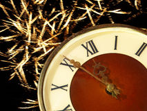 Eve of new year.Clock face and golden firework. Stock Photography