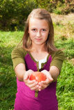 Eve Offering Apple. Pretty teenage girl doing an Adam & Eve apple concept shot Royalty Free Stock Photo