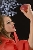 Eve Wish. Attractive woman looking at a red apple posing as Eve in the Garden of Eden Stock Images