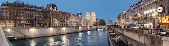 Eveing panorama of illuminated Paris and river Seine Stock Photo