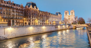 Eveing panorama of Paris with Notre-Dame cathedral Stock Image