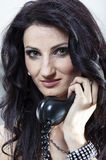 The Evelina: Beautiful and unrestrained girl. A girl with telephone handset Stock Images