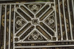 Artistically designed metal floor grate inside the Duomo di Milano. Even the floors received artistic treatment such as this designed metal floor grate in the Stock Photo