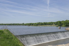 Even Flowing Dam at a Lake Royalty Free Stock Photography