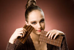 Even more chocolate. Even more chocolate, gorgeous young brunette girl with severe chocolate cravings Stock Photo