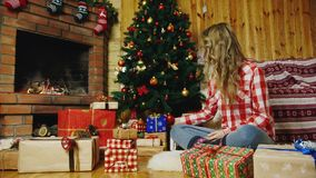 Even more Christmas presents under the tree stock footage