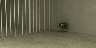 Even in prison. A simple metal toilet sits in the corner of a prison cell Stock Photography