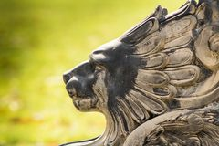 Even the regal lion stands powerless. A statue of a lion that seems to be crying after gazing at something revolting Stock Photos