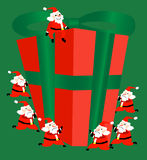 Even Santa needs teamwork. Seven santa with a big giftbox Royalty Free Stock Images