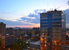 Evening сity. City view at sunset in the light of the lamps stock image