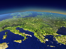 Evening above Adriatic sea region from space. Adriatic sea region from space in the evening sunlight with visible city lights. 3D illustration with detailed Stock Photography