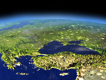 Evening above Turkey and Black sea region from space. Turkey and Black sea region from space in the evening sunlight with visible city lights. 3D illustration Stock Image