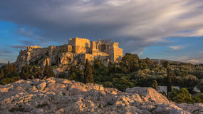 Evening at the Acropolis in Athens. The Acropolis at sunset. Clouds. In the foreground is the ancient stones Stock Photo