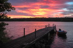 Evening ambiance at Golf of Finland. Boat and seagul on jetty. stock photo