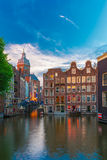 Evening Amsterdam canal, church and bridge Stock Photo