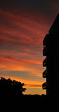 Apartment building silhouette during sunset Stock Photos