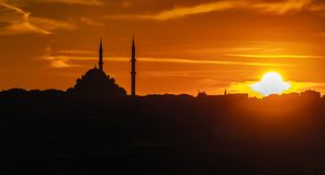 Evening atmosphere with dramatic sky over the dome and minarets of a mosque stock images