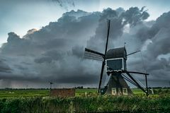 Windmill in Holland with Approaching Thunderstorm stock images