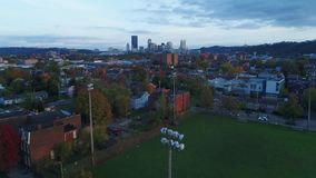 Evening autumn aerial rising establishing shot Pittsburgh skyline
