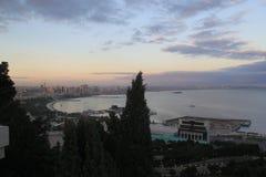 Evening Baku. Caspian sea, Baku, trees, sky and clouds Royalty Free Stock Image