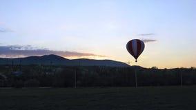 Evening balloon flight. Evening air balloon flight in the mountains Stock Image