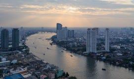 Evening Bangkok. View of the river and the urban masses. Thailand, Bangkok Royalty Free Stock Photo