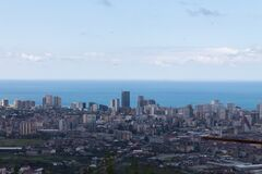 Evening Batumi on the background of the black sea and blue sky. Top view.