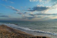 Evening beach. Sunset near Marina di Castiglione della Pescaia Stock Photography