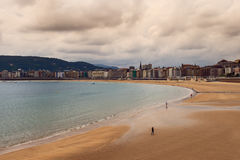 Evening beach on the Bay of Biscay in San Sebastian, Spain. San Sebastian is the most fashionable and prestigious resort of Spain on the Bay of Biscay Royalty Free Stock Photos