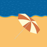 Evening beach with a beach umbrella Royalty Free Stock Photography