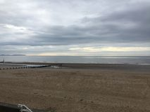 Evening beach and cloudy sky in Rhyl royalty free stock image