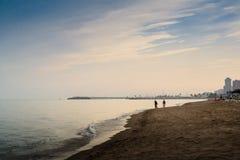 Evening At The Beach. A family having a walk at the Mediterranean beach at Fuengirola, Spain stock photo