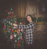 In the evening a beautiful girl near the Christmas tree. Stock Photography