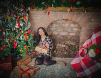 In the evening a beautiful girl near the Christmas tree. Royalty Free Stock Photo