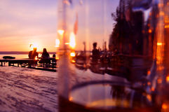 Evening in a beergarden. People enjoying the warm evening in a beergarden on a lake in Bavaria, Germany Stock Photos