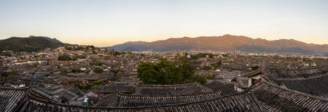 Evening bird eye view of local historical architecture roof building of Old Town of Lijiang in Yunnan, China. Stock Images