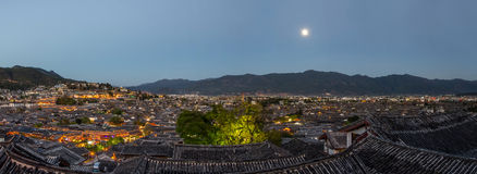 Evening bird eye view of local historical architecture roof building of Old Town of Lijiang in Yunnan, China. Royalty Free Stock Images
