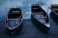 Boats on the lake by the water. Evening. Boats on the lake by the water Stock Photos