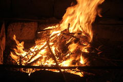 Evening bonfire. With yellow and orange flame royalty free stock photography