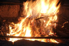 Evening bonfire. With yellow and orange flame stock images