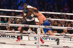 Evening of Boxing in the Palace of Sports in Kyiv. KYIV, UKRAINE - DECEMBER 12, 2015: Middleweight Dmytro Mytrofanov of Ukraine (blue shorts) fights with Marlo Royalty Free Stock Photos