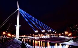 Evening bridge. Over the river with the external illumination Royalty Free Stock Photo