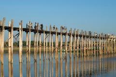 Evening on the bridge of U bein bridge. Myanmar Stock Photos
