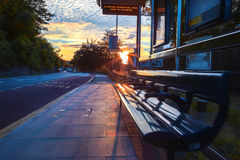 Evening bus stop. Last evening sun ray at bus stop Royalty Free Stock Photography