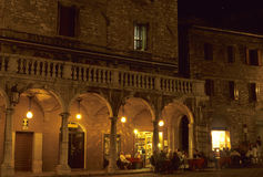Evening Caf, customers watching the  passagiatta. Stock Photos