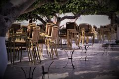 evening cafe before starting work in Tunisia, chairs raised - no customers royalty free stock photography
