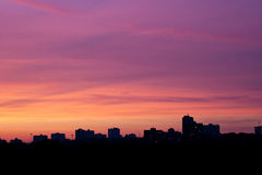 Evening calm sky color. Colorful sky at sunset over the city Stock Photo