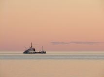 Evening calm sea with the ship Royalty Free Stock Photo