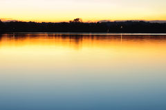 Evening calm water background. Royalty Free Stock Image