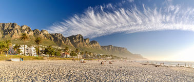 Evening at Camps Bay Beach - Cape Town, South Africa. Stunning evening XXL panorama of Camps Bay, an affluent suburb of Cape Town, Western Cape, South Africa Royalty Free Stock Image